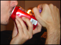 smoking from a can pipe