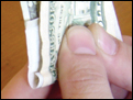 Rolling a joint using a dollar bill.