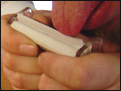 Using a joint roller to roll a joint.