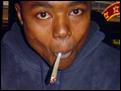 smoking a spliff.